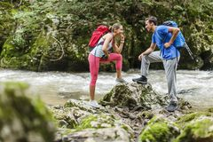 Couple hiking by the river Royalty Free Stock Photography