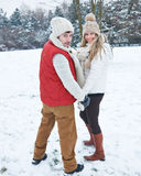 Couple hiking through snow in winter Stock Photos
