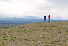 Couple hiking steppe Royalty Free Stock Image