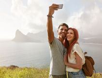 Couple hiking on a summer day Stock Images