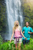 Couple hiking to waterfall royalty free stock photo