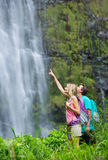Couple hiking to waterfall having fun Stock Images