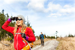 Couple hiking on trail in autumn forest Stock Photo