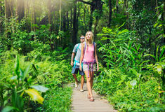 Couple hiking and walking through woods stock photos