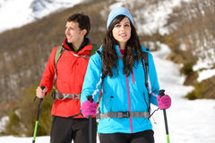 Couple hiking in winter mountain Stock Images