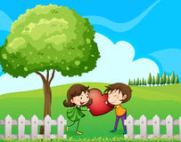 A couple at the hilltop near the wooden fence Stock Images