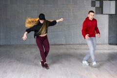 Couple of hip-hop dancers is dancing. Stock Photo