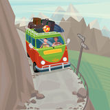 Couple in a hippie bus rides on the mountain serpentine. Young couple on funny hippie bus rides very carefully along a narrow mountain serpentine - Exotic Stock Image