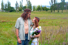 Couple hippie in love with flowers Stock Photography