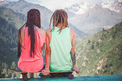 Couple of hippie, young people at mountain with longboard skatebord. Couple of hippie, young people at mountain with longboard skateboard. Longboard is the most royalty free stock photography