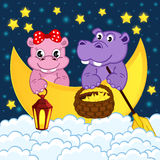 Couple of hippos float on moon in clouds Stock Photo