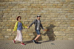Couple of hipsters: walking around old town. Vacation, summer, holiday, love Stock Photo