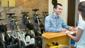 Couple hiring segways ot rental store Royalty Free Stock Photography
