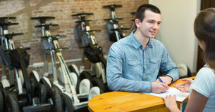 Couple hiring segways ot rental store Royalty Free Stock Photos