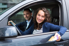 Couple in his car paying at a toll booth Stock Photography