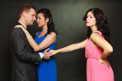Couple and his jealous woman lover Royalty Free Stock Photo