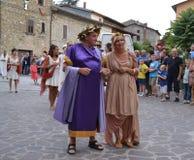 Couple in the historic roman clothing. Couple at the historic festival Navita di Maria in Umbria - Italy in roman costume Stock Photo