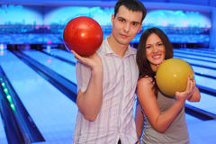 Couple hold balls in bowling club Stock Photo