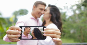 Couple Hold Cell Smart Phone Take Selfie Photo Embracing Kissing Outdoors Over Tropical Forest, Young Man And Woman. Happy Smiling Lovers Slow Motion 60 stock video footage