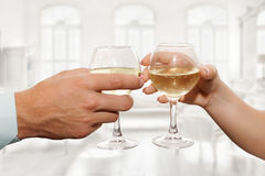 Couple hold glasses of champagne Stock Photos