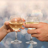 Couple hold glasses of champagne Stock Images
