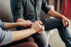 Couple hold hands, family psychology support royalty free stock photo