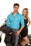 Couple hold jacket stand motorcycle Royalty Free Stock Photography
