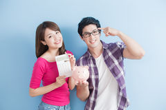 Couple hold pink pig bank Stock Photography