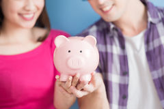 Couple Hold Pink Piggy Bank Royalty Free Stock Photography