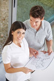Couple holding architectural drawing Stock Photography
