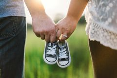 Couple holding baby shoes Royalty Free Stock Photos
