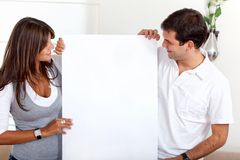 Couple holding a banner Royalty Free Stock Image