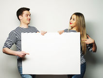 Couple holding a banner - isolated over a white background Stock Photography