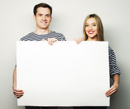 Couple holding a banner Stock Photos