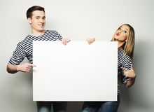 Couple holding a banner Stock Images