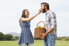 Couple holding basket full of apples Royalty Free Stock Photo