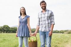 Couple holding basket full of apples Stock Photography