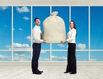 Couple holding big bag Royalty Free Stock Photo