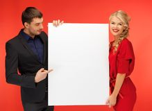 Couple holding big blank board Stock Images