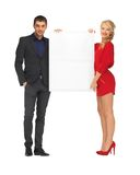 Couple holding big blank board Royalty Free Stock Photography