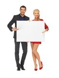 Couple holding big blank board Stock Photos