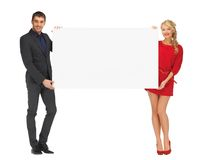 Couple holding big blank white board Stock Images
