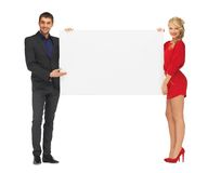 Couple holding big blank white board Royalty Free Stock Images