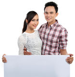 Couple holding blank banner on white Stock Photos