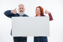 Couple holding blank card Royalty Free Stock Photos