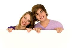 Couple holding blank sign Royalty Free Stock Image
