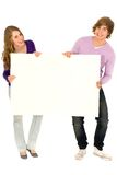Couple holding blank sign Royalty Free Stock Images