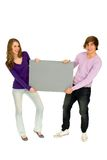 Couple holding blank sign Royalty Free Stock Photos