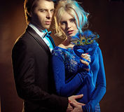 Couple holding a blue mask Royalty Free Stock Image
