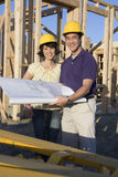 Couple Holding Blueprint Stock Image